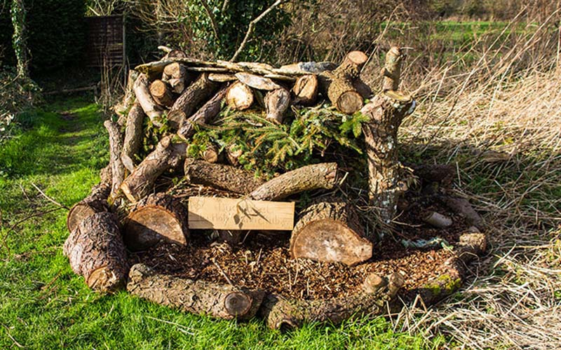 Log pile for insects
